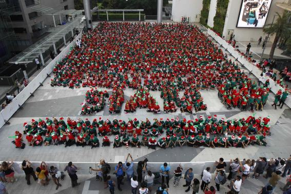 Students gather to break the Guinness World Record, for dressing as Santa's elves, in Bangkok