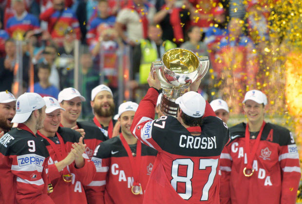 Canada's Sidney Crosby (R) raises the trophy of the IIHF Ice Hockey World Championship during the medal ceremony after the IIHF Ice Hockey World Championship final match Canada vs Russia on May 17, 2015 at the O2 Arena in Prague. Olympic champions Canada won the ice hockey world championship after sweeping defending champions Russia 6-1 in the final.     AFP PHOTO / MICHAL CIZEKMICHAL CIZEK/AFP/Getty Images