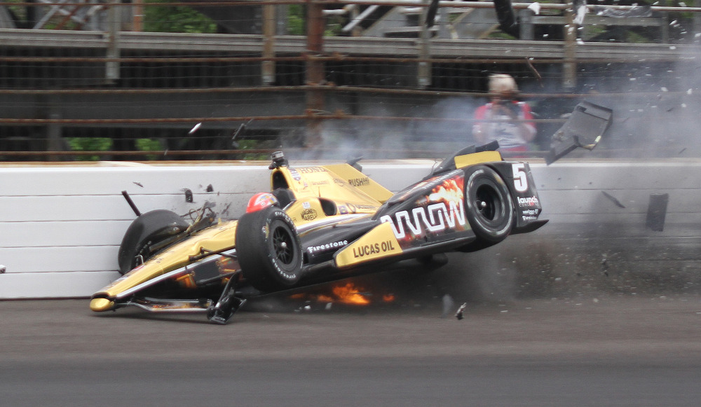 James Hinchcliffe, of Canada, hits the wall in the third turn during practice for the Indianapolis 500 auto race at Indianapolis Motor Speedway in Indianapolis, Monday, May 18, 2015.  (Jimmy Dawson/The Indianapolis Star via AP) ORG XMIT: ININS101
