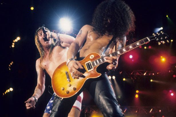 Axl-Rose-and-Slash-of-Guns-N-Roses-perform-live-at-Rock-In-Rio-II-on-January-15-1991