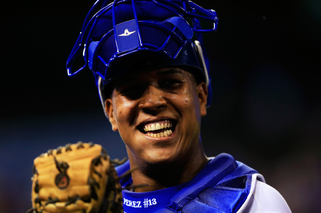 KANSAS CITY, MO - SEPTEMBER 03:  Catcher Salvador Perez #13 of the Kansas City Royals reacts to fans' cheers after the Royals defeated the Seattle Mariners 4-3 to win the game at Kauffman Stadium on September 3, 2013 in Kansas City, Missouri.  (Photo by Jamie Squire/Getty Images)