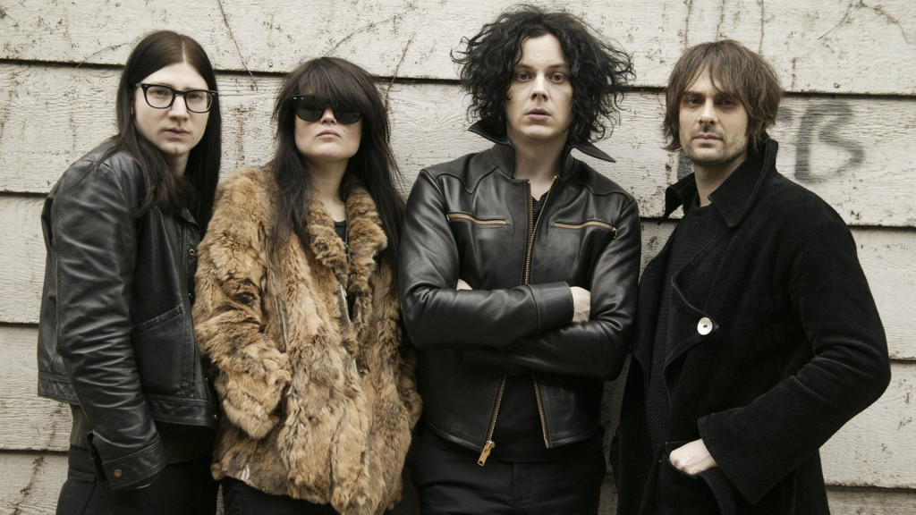 The Dead Weather, from left, Jack Lawrence, Alison Mosshart, Jack White and Dean Fertita pose in Nashville, Tenn., Wednesday, March 11, 2009. (AP Photo/Ed Rode)