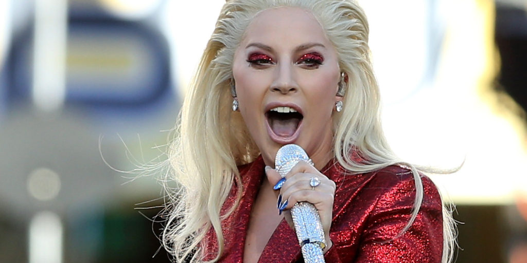 SANTA CLARA, CA - FEBRUARY 07:  Recording artist Lady Gaga performs the national anthem prior to Super Bowl 50 between the Denver Broncos and the Carolina Panthers at Levi's Stadium on February 7, 2016 in Santa Clara, California.  (Photo by Streeter Lecka/Getty Images)