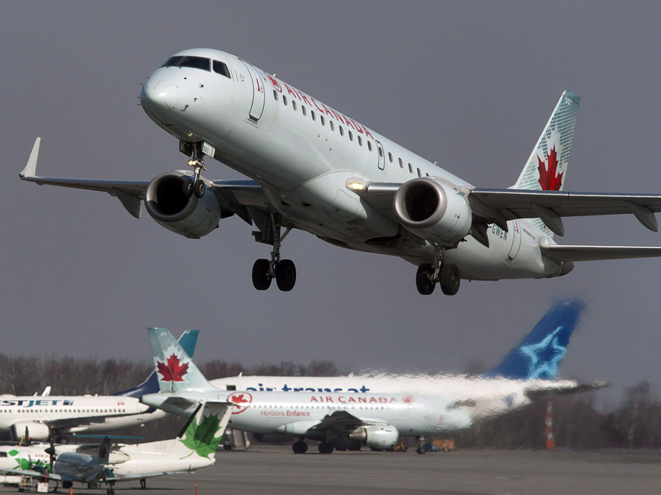 An Air Canada jet takes off from Halifax Stanfield International Airport in Enfield, N.S. on Thursday, March 8, 2012. Air Canada has announced it is changing its policy on the number of people required in the cockpit of its aircraft, a move prompted by the Germanwings plane crash in France. THE CANADIAN PRESS/Andrew Vaughan 0813-biz-xFPaircan ORG XMIT: POS2015032617333437 1118-biz-xFPairclimate ORG XMIT: POS1508121315441720