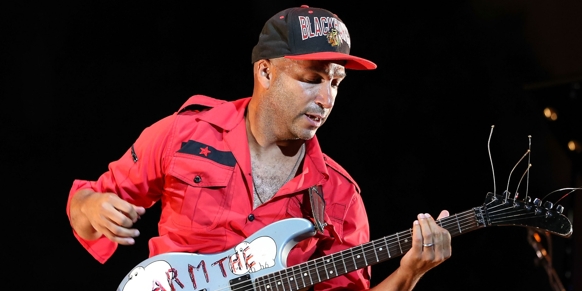 HOLLYWOOD, CA - SEPTEMBER 06:  Guitarist Tom Morello performs onstage during 'Rock Out!' at Ford Theatre on September 6, 2013 in Hollywood, California.  (Photo by Imeh Akpanudosen/Getty Images)