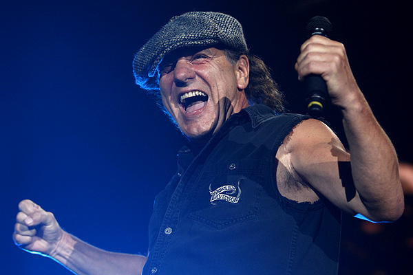 Singer Brian Johnson performs before a strong crowd.