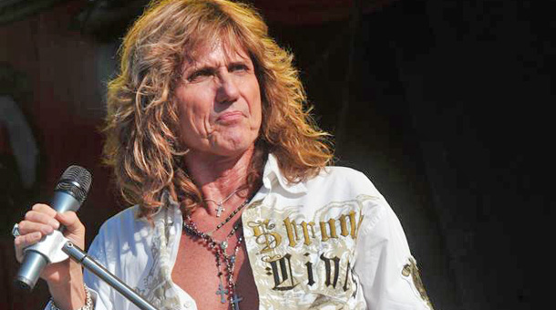 DERBY, UNITED KINGDOM - JUNE 14: David Coverdale of rock group Whitesnake performing live on stage at Download Festival on June 14, 2009 at Donington Park. (Photo by Kevin Nixon/Classic Rock Magazine)  David Coverdale . CONTACT: Future Publishing Limited 30 Monmouth St, Bath, UK, BA1 2BW +44 (0)1225 442244 licensing@futurenet.com www.futurelicensing.com, www.futureplc.com
