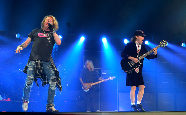 GREENSBORO, NORTH CAROLINA - AUGUST 27:  Axl Rose, left, and Angus Young perform with AC/DC during the Rock Or Bust Tour at the Greensboro Coliseum on August 27, 2016 in Greensboro, North Carolina.  (Photo by Jeffrey A. Camarati/Getty Images)