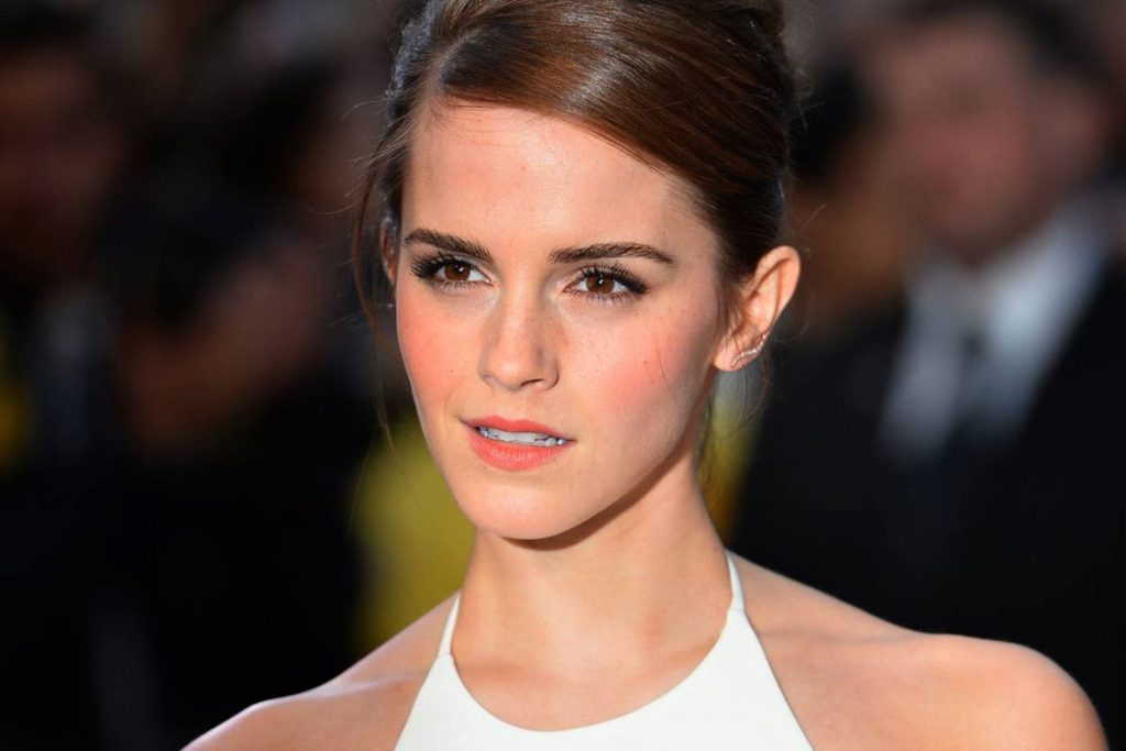 """British actress Emma Watson poses for pictures on the red carpet as she arrive for the UK premiere of her latest film """"Noah"""" in Leicester Square, central London, on March 31, 2014. AFP PHOTO/BEN STANSALL        (Photo credit should read BEN STANSALL/AFP/Getty Images)"""